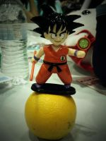 Goku on an Orange by AndroidKitteh