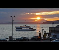 Ferry at Sunset by Val-Faustino