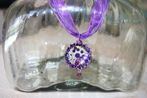 purple Steampunk bottle cap necklace by SuperFlashDance