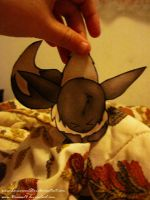 Paper-Child Clinging Eevee by LunarousCrescent