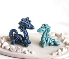 Blue and turquoise dragons by vavaleff