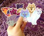 Wuffies Stickers In Hand by Goldenwolf