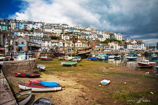 Brixham Harbour at low tide, July 2016. by Zin-Carla