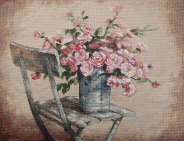 Roses on a white chair by tasamajamarina