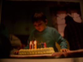 Me blowing out the candles on my Yogi Bear Cake by jhwink