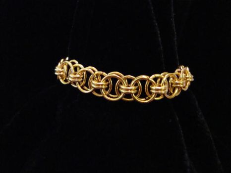 Gold Jumpring Bracelet by NightShrike