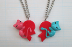Mew Friendship Pendants by SneakyCinnamon
