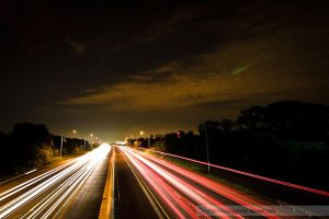 highway at night by fuzzypanda0
