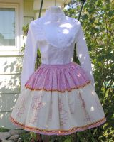 Pink doll print skirt by The-Cute-Storm