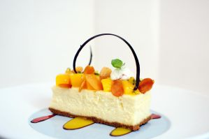 Coconut and Chevre Cheesecake, Mango Salsa, Almond by aperture24