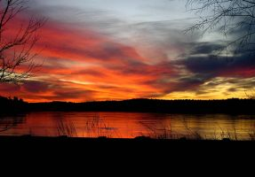 Sunset over Frozen Lake by muffet1