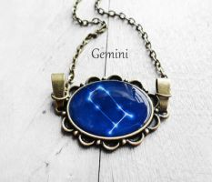 Handmade Resin Gemini Bronze Oval Necklace by crystaland
