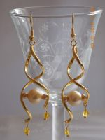 Spiral gold earrings by Quested-Creations