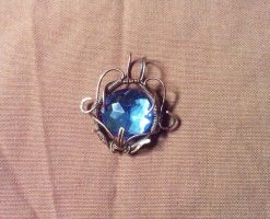 Blue wire wrapped pendant by EatThatCookie