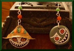 Skullkid and Puppet earrings by kaidenmoon