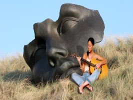 Playing the guitar by Flore