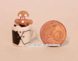 Teeny, tiny gingerbread man 1 by 3timesC