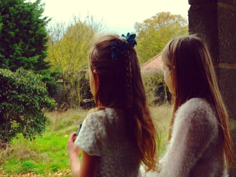 Little girls on the wall by ClaudiaPPhotography