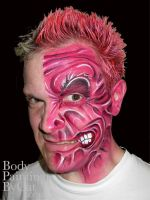 Two Face batman face paint by Bodypaintingbycatdot