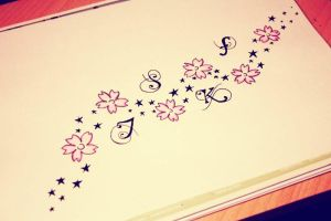 Tattoo flowers with stars by auriedessin